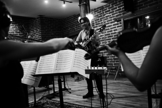 In studio w/strings. Photo by Mikel Patrick Avery.